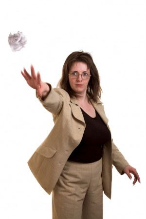 Woman throwing paper
